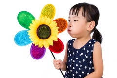 Asian Little Chinese Girl Blowing Colorful Windmill Stock Image