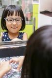 Asian Little Chinese Girl Choosing Glasses Stock Photos