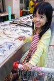 Asian Little Chinese Girl choosing seafood Stock Images