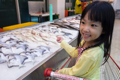 Asian Little Chinese Girl choosing seafood Stock Photography