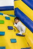 Asian Little Chinese Girl climbing up ramp Royalty Free Stock Photos