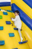 Asian Little Chinese Girl climbing up ramp Royalty Free Stock Photos