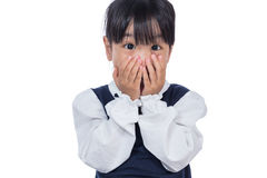 Asian Little Chinese Girl covering her face Stock Images