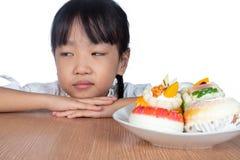 Asian Little Chinese Girl dislike dessert Royalty Free Stock Photography