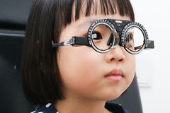 Asian Little Chinese Girl Doing Eyes Examination Royalty Free Stock Image