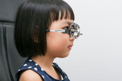 Asian Little Chinese Girl Doing Eyes Examination Royalty Free Stock Photo