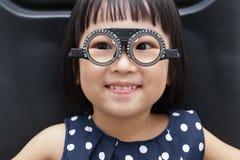 Asian Little Chinese Girl Doing Eyes Examination Stock Photos
