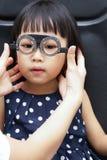 Asian Little Chinese Girl Doing Eyes Examination Royalty Free Stock Images