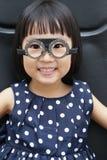 Asian Little Chinese Girl Doing Eyes Examination Royalty Free Stock Image