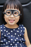 Asian Little Chinese Girl Doing Eyes Examination Royalty Free Stock Photo
