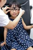 Asian Little Chinese Girl Doing Eyes Examination Stock Photography