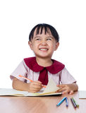 Asian Little Chinese girl drawing with color pencils Royalty Free Stock Images