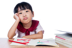 Asian Little Chinese girl drawing with color pencils Royalty Free Stock Photography