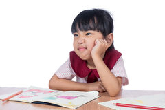Asian Little Chinese girl drawing with color pencils Royalty Free Stock Photos