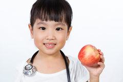 Asian Little Chinese Girl Dressed up as Doctor with a Stethoscop Royalty Free Stock Images