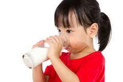 Asian Little Chinese Girl Drinking a cup of Milk. Isolated on White Background Royalty Free Stock Photo