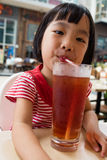 Asian Little Chinese Girl Drinking Ice Tea Royalty Free Stock Photo