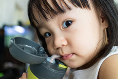 Asian Little Chinese Girl Drinking Water Royalty Free Stock Photography