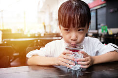 Asian little Chinese girl drinking water Stock Photos