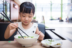 Asian little Chinese girl eating beef noodles soup Royalty Free Stock Photography