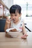 Asian little Chinese girl eating braised pork rice Stock Images