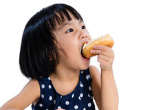 Asian Little Chinese Girl Eating Donuts Stock Photos