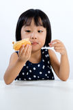 Asian Little Chinese Girl Eating Donuts Stock Photo