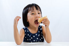 Asian Little Chinese Girl Eating Donuts Royalty Free Stock Images