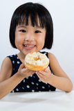 Asian Little Chinese Girl Eating Donuts Royalty Free Stock Photography