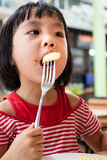 Asian Little Chinese Girl Eating French Fries Royalty Free Stock Images