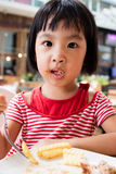 Asian Little Chinese Girl Eating French Fries Stock Photography