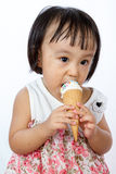 Asian Little Chinese Girl Eating Ice Cream Stock Image