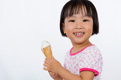 Asian Little Chinese Girl Eating Ice Cream Stock Photos