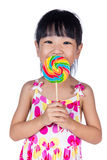 Asian Little Chinese girl eating lollipop Royalty Free Stock Photos