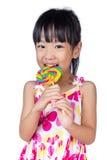 Asian Little Chinese girl eating lollipop Stock Image