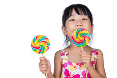 Asian Little Chinese girl eating lollipop Royalty Free Stock Images