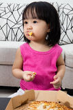 Asian Little Chinese Girl Eating Pizza Stock Image