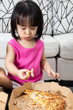 Asian Little Chinese Girl Eating Pizza Royalty Free Stock Photo