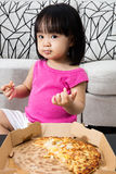 Asian Little Chinese Girl Eating Pizza Stock Photos