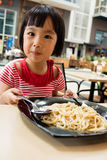 Asian Little Chinese Girl Eating spaghetti Royalty Free Stock Photo
