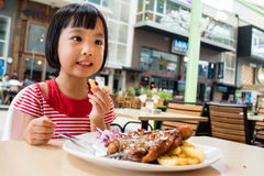 Asian Little Chinese Girl Eating Western Food Stock Photos