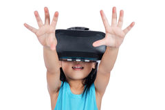 Asian little Chinese girl experiencing virtual reality via VR go Royalty Free Stock Images