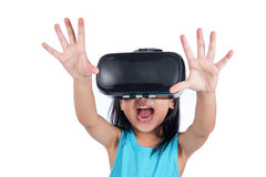 Asian little Chinese girl experiencing virtual reality via VR go Stock Photography