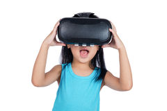 Asian little Chinese girl experiencing virtual reality via VR go Royalty Free Stock Photos