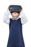 Asian little Chinese girl experiencing virtual reality via VR go Royalty Free Stock Photo