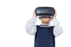 Asian little Chinese girl experiencing virtual reality via VR go. Ggles in isolated white background Stock Photo