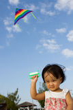 Asian Little Chinese Girl Flying Kite Royalty Free Stock Images