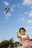 Asian Little Chinese Girl Flying Kite Stock Photography