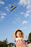Asian Little Chinese Girl Flying Kite Stock Images