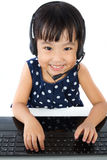 Asian Little Chinese Girl in Headset with Laptop Stock Photos